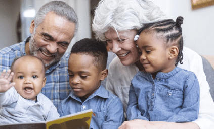 Grandparents with children reading